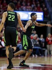 Michigan State's Cassius Winston (5) celebrate his