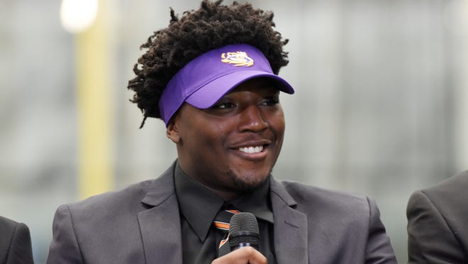 Tyler Taylor of Lanier High School, who committed to LSU, speaks during a signing day event in Atlanta, Wednesday, Feb. 1, 2017. (David Barnes/Atlanta Journal-Constitution via AP)