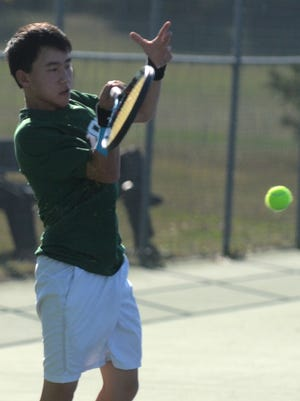 Novi's Alex Wen flips a forehand in his No. 2 singles match Thursday at Northville.