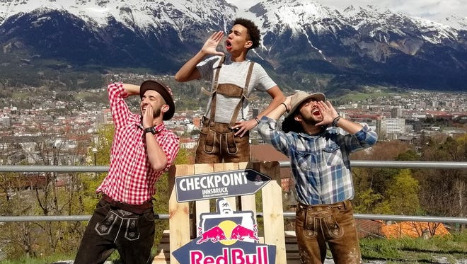"""Team Naray - Jonah Kennon, Torbyn Nara and Emilio Baca - demonstrate their yodelling in traditional lederhosen fashion while at the Innsburk, Austria, checkpoint during the Red Bull """"Can You Make It?"""" adventure challenge."""