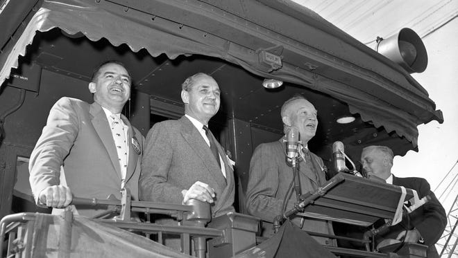 Dwight D. Eisenhower steps before the microphones while (from left) U.S. Sen. Joseph R. McCarthy (R-Wis.), Gov. Walter Kohler and Sen. Alexander Wiley (R-Wis.) look on during a campaign stop in Appleton on Oct. 3, 1952. The train went on to Milwaukee. This photo was published in the Oct. 4, 1952, Milwaukee Journal.