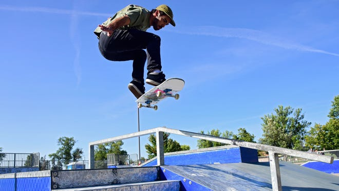 Robert Stocker gets air off a metal ramp at Drake Springs Skateboard Park on  Sept. 7. Sioux Falls skaters say the time has come to upgrade from the metal ramps used at Drake Springs and Kuehn Park to a concrete park.