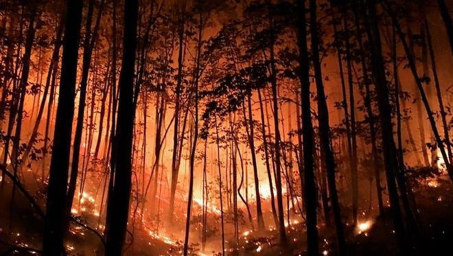 A fire continues to burn on Pinnacle Mountain in Pickens County, S.C.
