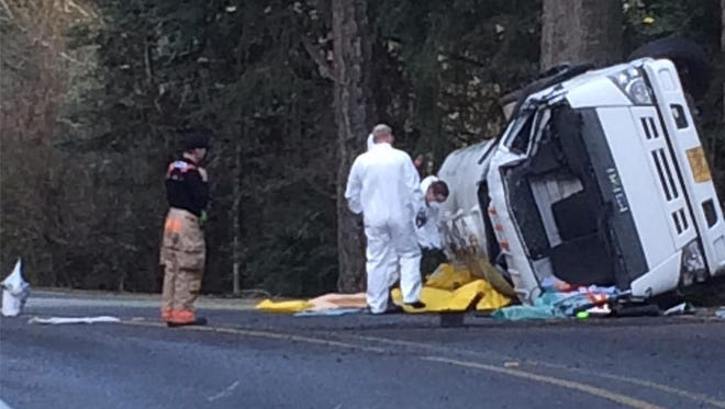 Responders work to clear a crash on Vitae Springs Road S Monday morning.