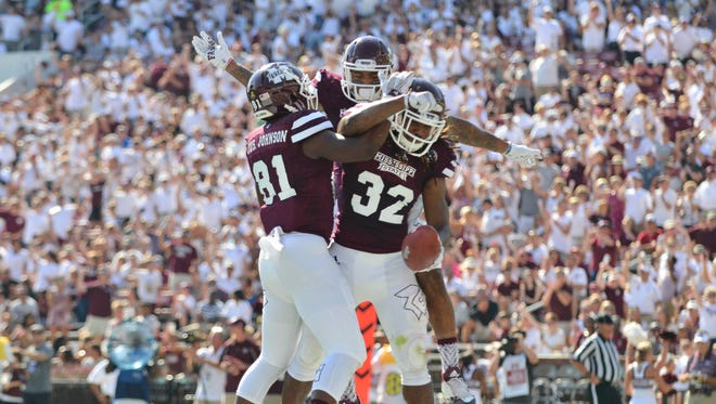 Sep 19, 2015; Starkville, MS, USA; Mississippi State Bulldogs wide receiver Justin Johnson (81) and wide receiver Donald Gray (6) and running back Ashton Shumpert (32) celebrate after a touchdown by Shumpert  during the first quarter of the game against the Northwestern State Demons at Davis Wade Stadium. Mandatory Credit: Matt Bush-USA TODAY Sports