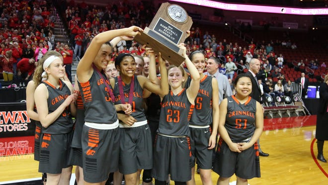 The Grinnell Tigers hoist their trophy for the Grinnell fans following their 69-48 loss to Marion in the Class 4A championship game at Wells Fargo Arena on Friday, March 2.