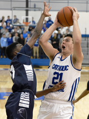 Catholic Central's C.J. Baird (right) scored a team-high