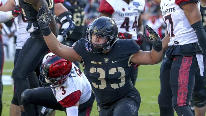 Army running back Darnell Woolfolk, center, reacts after his touchdown run against San Diego State during the first half of the Armed Forces Bowl on Saturday in Fort Worth, Texas.