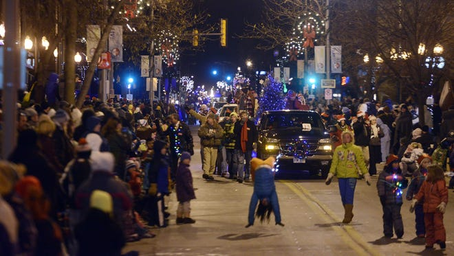 The Parade of Lights rolls through downtown Sioux Falls Friday, Nov 29, 2013.  (Elisha Page / Argus Leader)