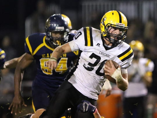 Cascade's Garrett Coffey runs the ball as the Cougars defeat Stayton 31-7 in an Oregon West Conference game on Oct. 16.