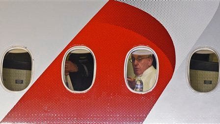 Pope Francis looks out the window of a plane as he prepares to depart Philadelphia International Airport on Sunday on his way back to Rome. Pope Francis wrapped up his 10-day trip to Cuba and the United States on Sunday.
