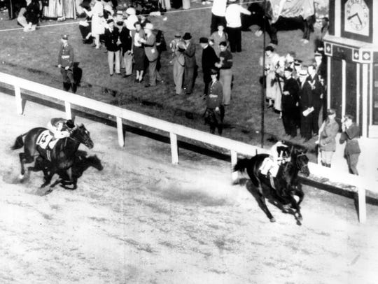 War Admiral (right) wins the 1937 Kentucky Derby.