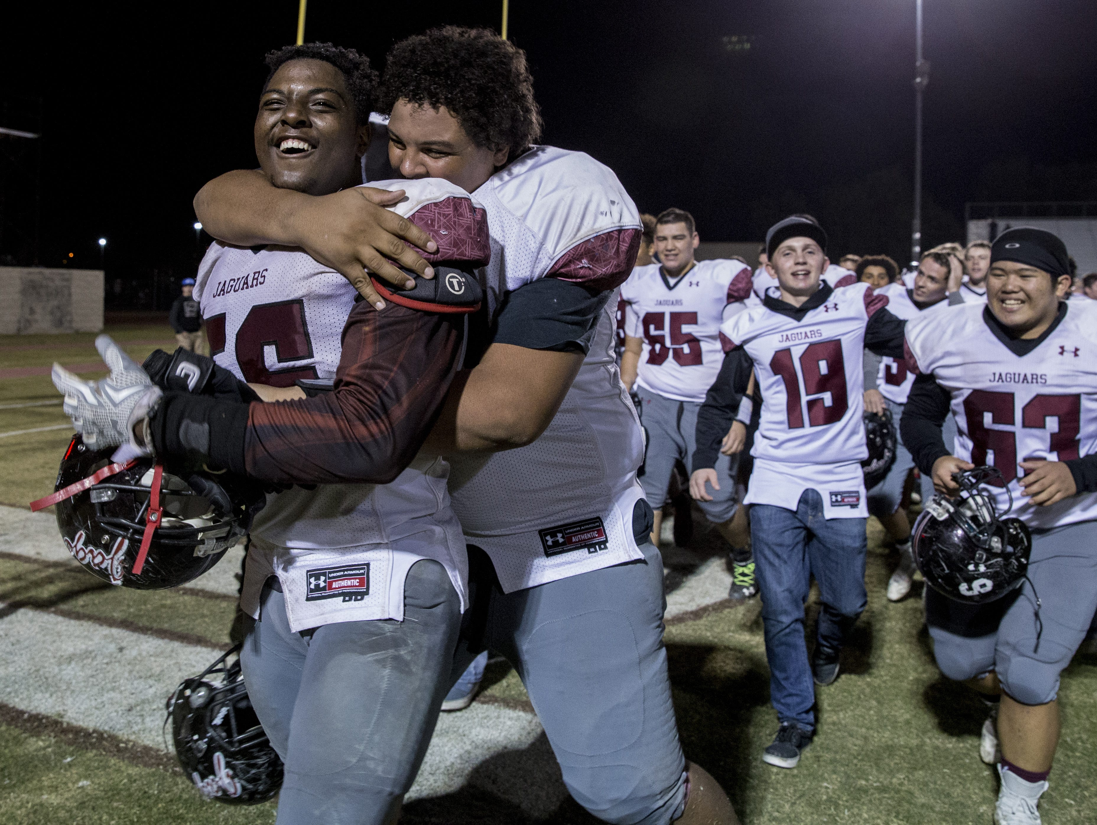 Desert Ridge's Maurice Walton Jr. (right) hugs Andre Elmore after defeating Chandler on Friday, Nov. 20, 2015 during the Division I state semifinals at Hamilton High School in Chandler.