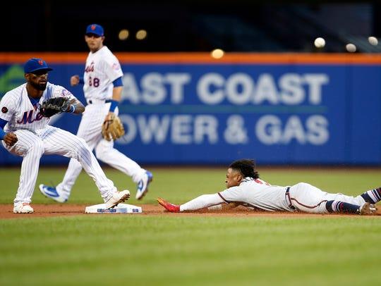 Atlanta Braves second baseman Ozzie Albies (1) steals