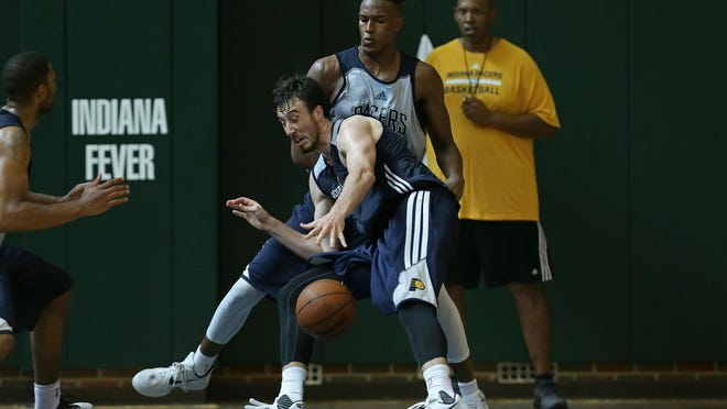 NBA draft prospect Myles Turner (back) guards Frank Kaminsky (front) during an Indiana Pacers pre-draft work out, Sunday, June 14, 2015, at Banker's Life Field House, Indianapolis.