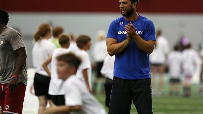 Indianapolis Colts quarterback Andrew Luck runs passing drills with children ages 5-13 during a free Change the Play fitness camp for kids, Sunday, July 19, 2015, John Mellencamp Pavilion, Bloomington, Ind.