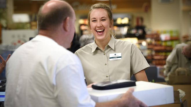 Lauren Gillson smiles while talking with a customer at Lunds & Byerlys in St. Cloud.