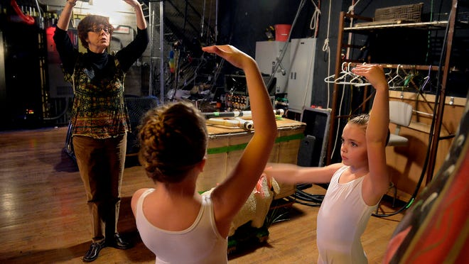 """Linda Fuller of Miss Linda's School of Dance works with Kaylee Hill, left, and Brooklyn Griffin backstage in the Mansfield Theater during rehearsal for the Moscow Ballet's production of """"The Nutcracker"""" on Wednesday evening."""