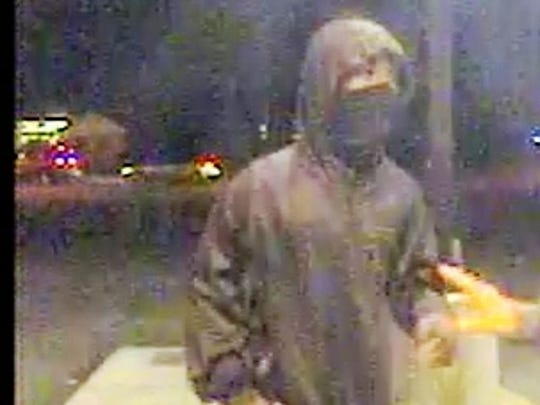 Roseville police are trying to identify a man who robbed a resident at gunpoint when he used a local bank ATM Monday night.