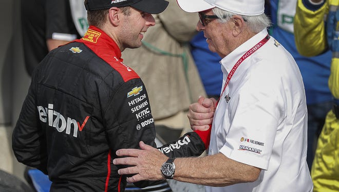 Team Penske IndyCar driver Will Power (12) celebrates winning the IndyCar Grand Prix with team owner Roger Penske, right,  at the Indianapolis Motor Speedway on Saturday, May 12, 2018.