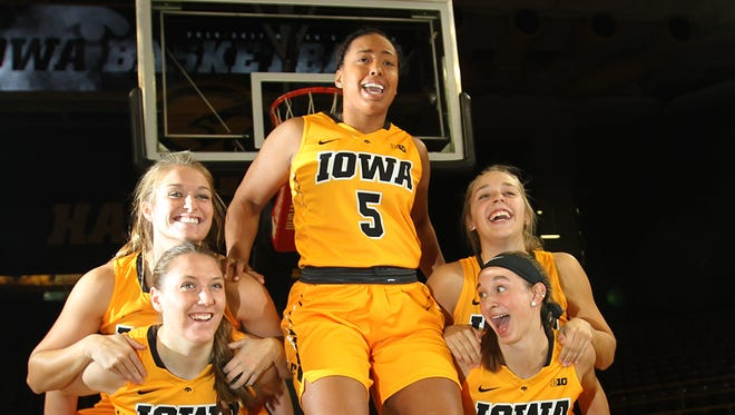 Alexis Sevillian poses with her fellow freshman class poses for a photo during media day at Carver-Hawkeye Arena on Wednesday, Oct. 26, 2016.