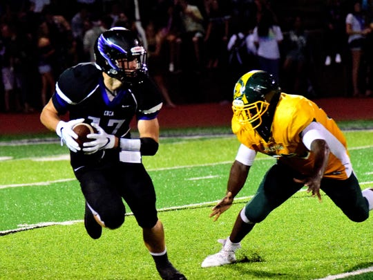 Taft's D'meko Pryor (55) gives chase to Adam Baker (17) of CHCA as he looks to return a punt, September 16.