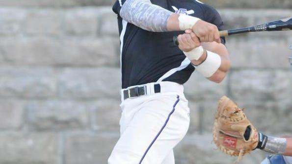 Fremont Ross' Kole Amor hits a triple during a baseball game against Sandusky on Thursday, May 8, 2014.