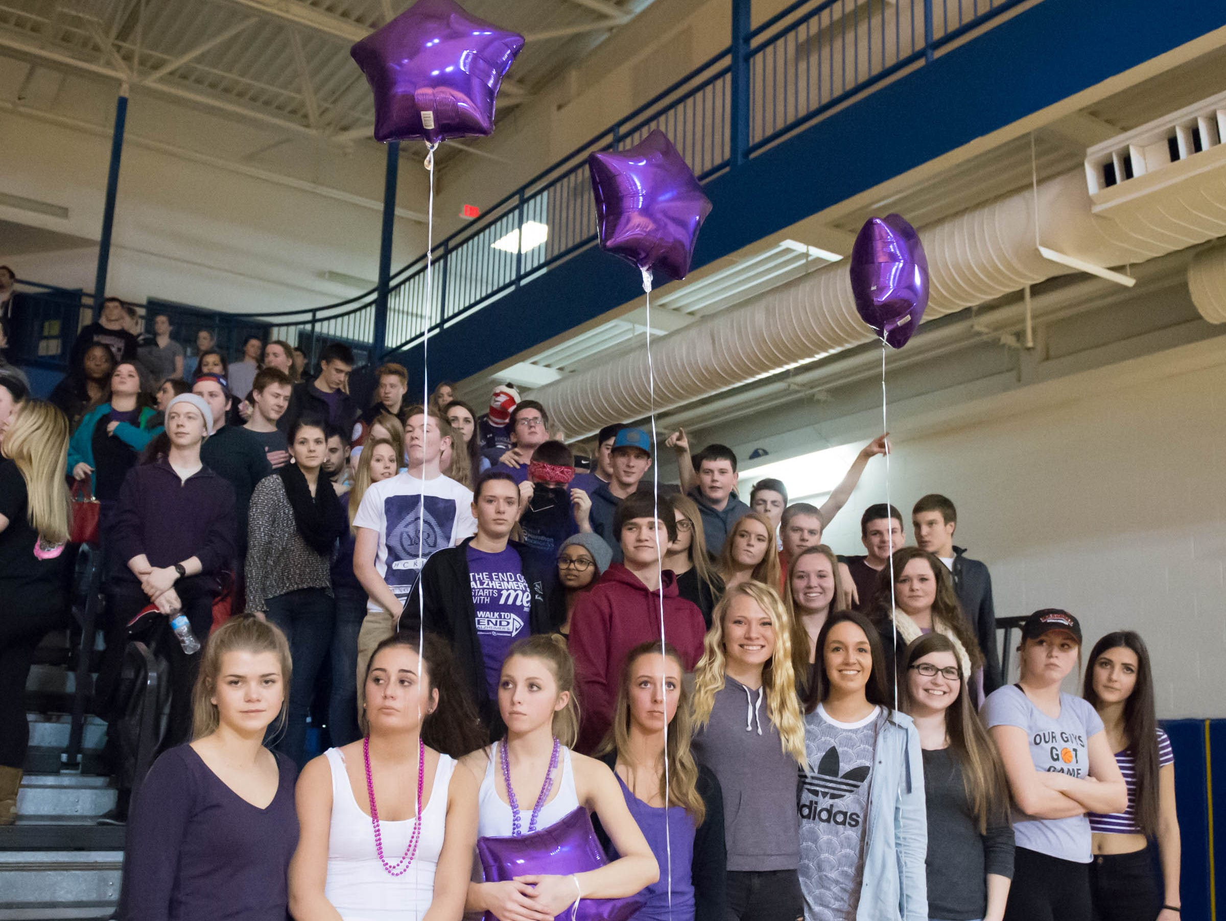 The Marshall student section wore purple to honor former Marshall player and teacher Kari Searles Jolink, who passed on Wednesday after a long fight with cancer.