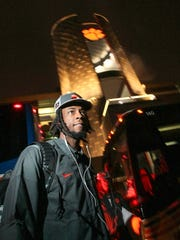 Clemson receiver Mike Williams walks to his car Sunday after returning from Arizona to Memorial Stadium.