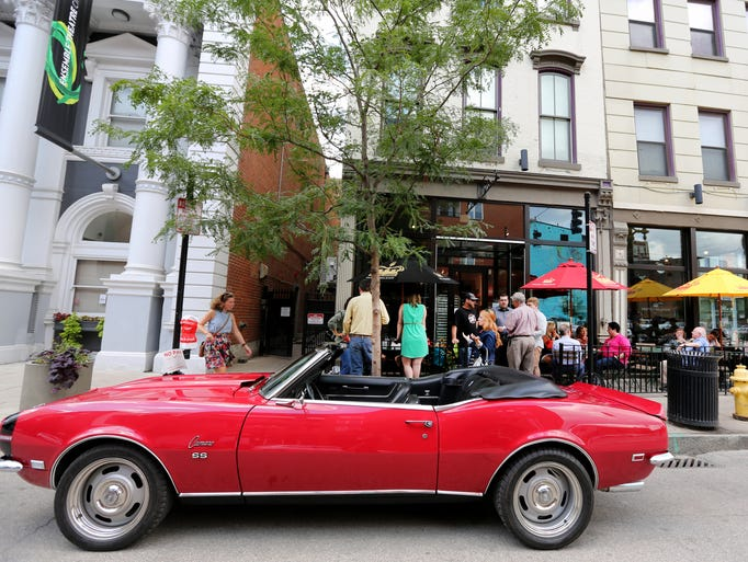 "Guy Fieri's red Camaro was parked in front of Taste of Belgium in Over-the-Rhine, where Fieri was filming ""Diners, Drive-ins and Dives"" on Wednesday, July 9, 2014. He also filmed at Bakersfield OTR."