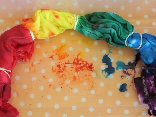 For the rainbow tie dye pattern, rubber band a T-shirt