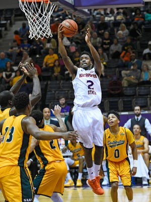 Northwestern State's Ta'Jon Welcome goes up for a shot against SLU.