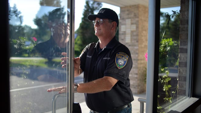 Millville police chaplain Bob Ossler steps out of the worship center at Cumberland County Community Church, Tuesday, Jul. 12, 2016 in Millville.