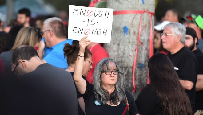 Thousands of grieving students, family members and school staff joined a candlelight vigil at Pine Trails Park in Coral Springs,Thursday, Feb. 15, 2018, for the victims of a mass shooting at Marjory Stoneman Douglas High School in Parkland, Florida.