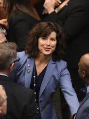 Senator Heidi Gansert walks the senate chambers as