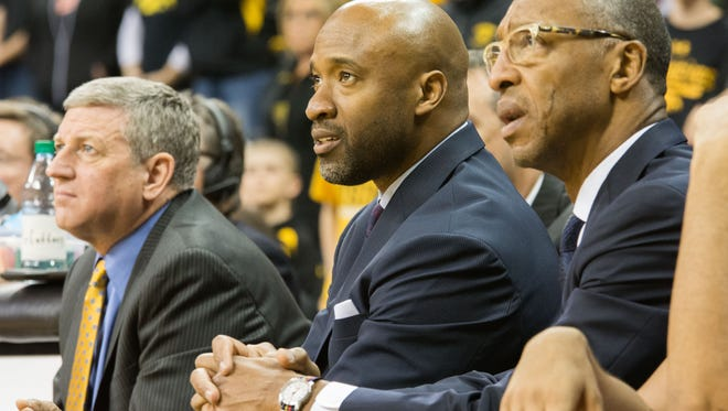 Iowa assistant coaches Kirk Speraw, from left, Andrew Francis and Sherman Dillard watch the Hawkeyes face Purdue at Carver-Hawkeye Arena on Sunday, Jan. 24, 2015