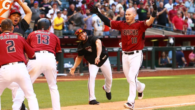 Arizona Diamondbacks Chris Herrmann (10) hits a walk-off game winning home run against the New York Mets in the 11th inning on Wednesday, May 17, 2017 at Chase Field in Phoenix, Ariz.