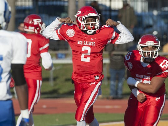 Paulboro's Kyle Jones , 2, reacts after scoring a touchdown during Saturday's South Jersey Group 1 final.