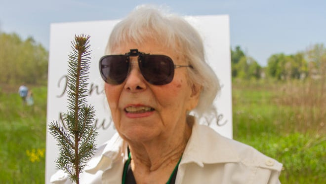 Irene Gossin at the May 22 ribbon cutting on the Penfield nature preserve named in her honor. She gave away thousands of small potted evergreens during her political campaigns.