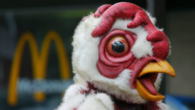 """Abby the Abused Chicken"" stands in protest at the Monroe Avenue McDonald's on Friday."