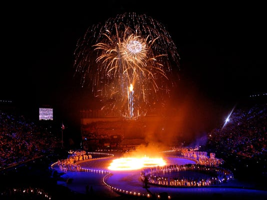 FILE - This Feb. 8, 2002 file photo shows fireworks erupting during the opening ceremonies of the 2002 Winter Olympics in Salt Lake City. There's an outside shot the United States won't have to wait 11 years to host its next Olympics. It's a longshot, but there's talk in Salt Lake City, and even some in Denver, of a bid for the 2026 Winter Games, which take place two years before the Summer Olympics return to Los Angeles. (AP Photo/Kevork Djansezian, file)
