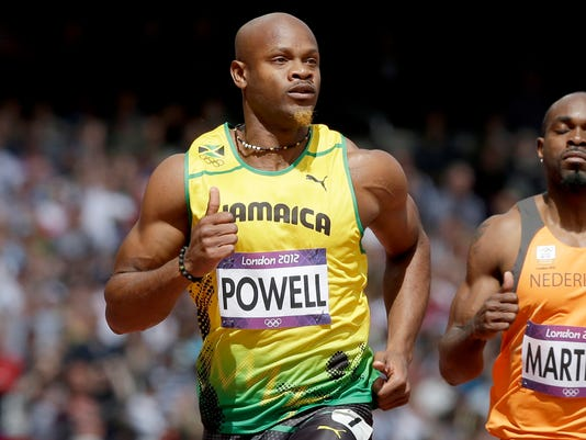 FILE - In this Aug. 4, 2012 file photo, Jamaica's Asafa Powell, competes in a men's 100-meter heat during the athletics in the Olympic Stadium at the 2012 Summer Olympics, London.  The president of the World Anti-Doping Agency is traveling to Jamaica to check whether the Caribbean island has put its house in order and set up an effective drug-testing program in the tiny nation that produces the world's dominant sprinters, it was reported on Friday, Feb. 20, 2015. Craig Reedie will become the first WADA president to visit Jamaica, which came under scrutiny following revelations of a complete lack of out-of-competition testing among its athletes in the months before the 2012 London Olympics. Eight Jamaican athletes tested positive in 2013, including former 100-meter record holder Asafa Powell and three-time Olympic medalist Sherone Simpson. (AP Photo/Anja Niedringhaus, File)