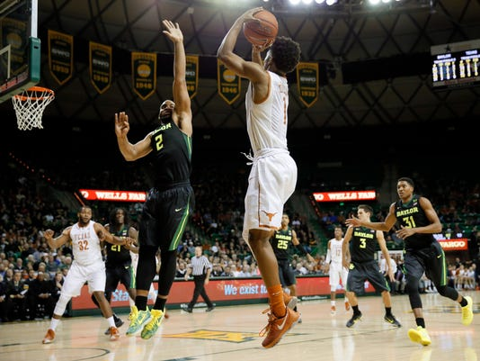 Texas guard Isaiah Taylor (1) attempts a shot over Baylor forward Rico Gathers (2) in the first half of an NCAA college basketball game, Monday, Feb. 1, 2016, in Waco, Texas. (AP Photo/Tony Gutierrez)