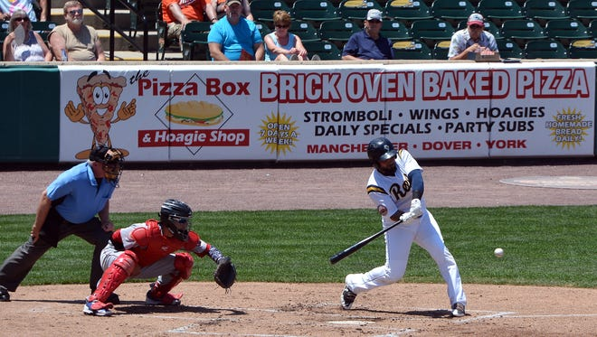 Ryan Dent connects with a two-RBI hit in the first inning as the York Revolution face the Lancaster Barnstormers, Sunday, June 11, 2017. Dent led York with two RBIs in Tuesday's 12-9 loss to Southern Maryland. John A. Pavoncello photo