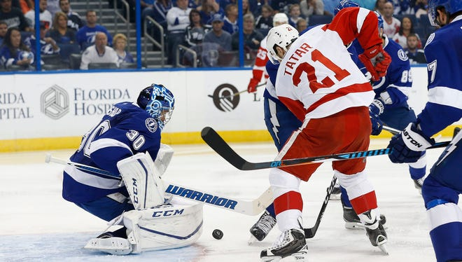 Oct 13, 2016; Tampa, FL, USA;  Tampa Bay Lightning goalie Ben Bishop makes a save against Red Wings left wing Tomas Tatar during the second period at Amalie Arena.