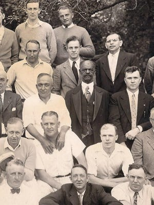 Charles R. Hull, center, with members of the Fairport Businessmen's Club.