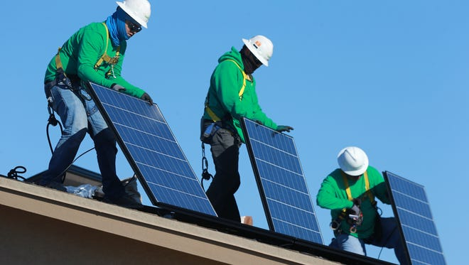 SolarCity technicians Rey Dominguez, Jesus Villasana and Manny Rivera recently installed solar panels at a home on Jericho Tree Drive in Northeast El Paso.