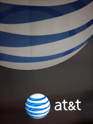 An AT&T logo and sign are seen on a window at a company store in Brunswick, Maine, in 2010.