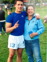 Nicolet High School alumnus Ryan Miller is pictured with his mother, Mari Jo Miller, during his high school years. Miller died last year at the age of 24, and now his family is creating a rugby scholarship in his name.