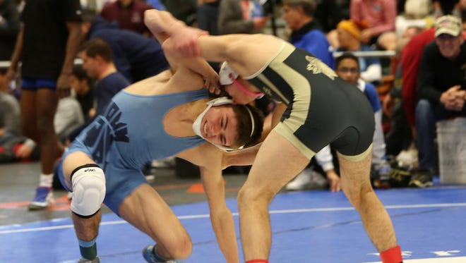 John Jay East Fishkill's Randy Earl and Wantagh's Justin Vines wrestle in the semifinals of the 126-pound weight class during the Eastern States Classic Wrestling Tournament at Sullivan Community College in Loch Sheldrake, N.Y. Jan. 14, 2017.  Vines won the match.